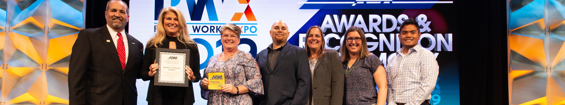 A group of public works professionals receive an APWA award at PWX
