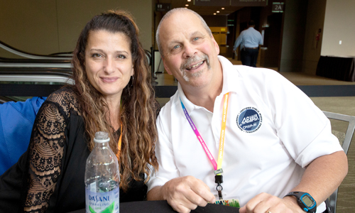 Two APWA members networking at a conference
